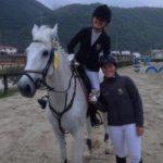 Scuola equitazione Kappa Equestre istruttore con allievo a cavallo