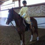 Scuola equitazione Kappa Equestre bambino su cavallo